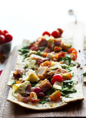 Spinach Artichoke Flatbread Pizza on a serving platter
