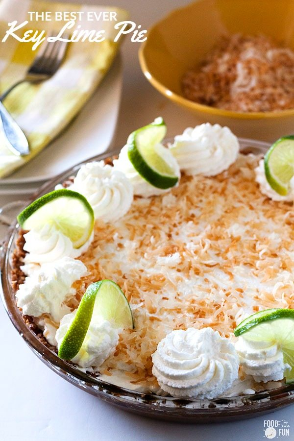 Key lime pie with a coconut graham cracker crust in a pie plate