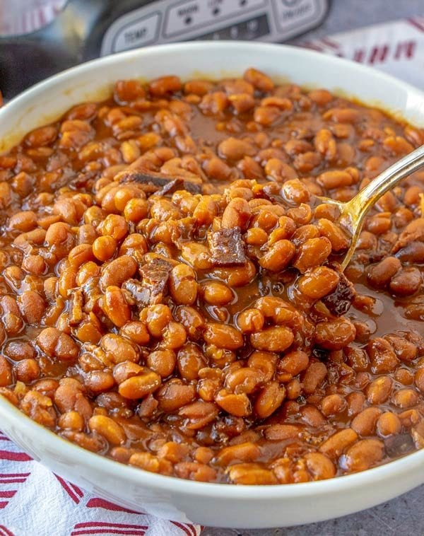 A spoon full of Boston Baked Beans.