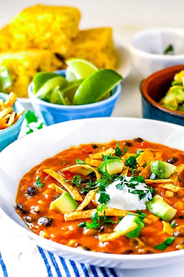 Chicken Enchilada Soup in a white bowl.