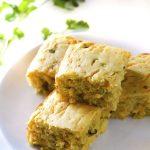 Cheesy Green Chile Cornbread squares on a plate