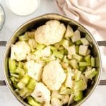 Add the cauliflower and broth to a pot and simmer until tender .