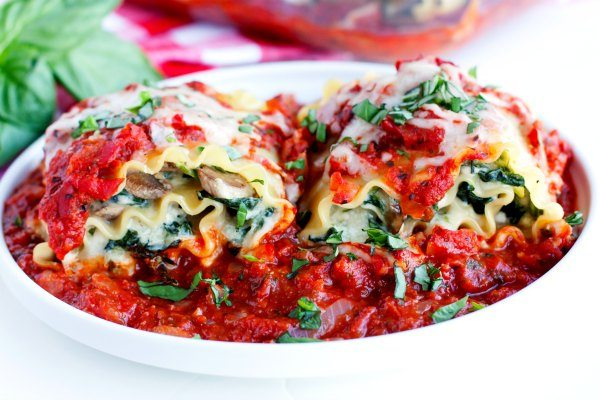 This skinnier Lasagna Roll Ups recipe is packed with mushrooms, spinach, and smothered in a vibrant homemade sauce. Come find out the secret to cutting fat without cutting flavor!