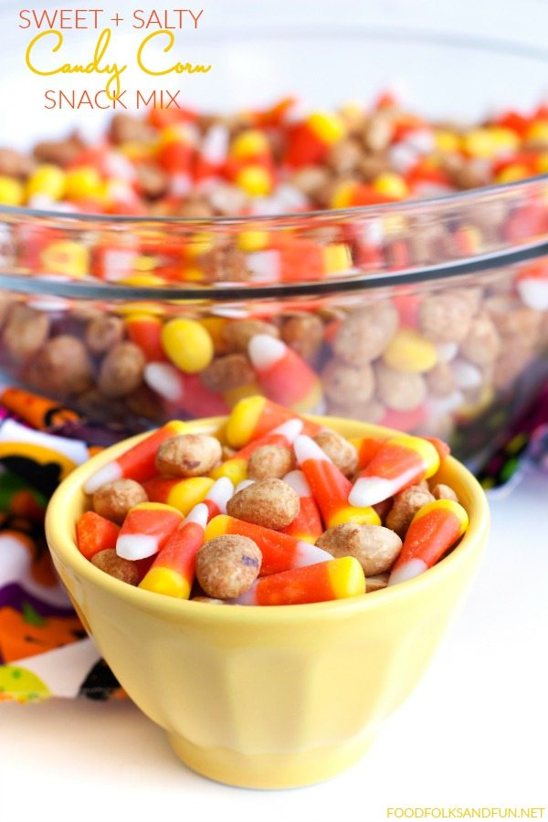 As if candy corn wasn't addicting enough, this Candy Corn Snack Mix is the perfect combination of salty and sweet that makes it irresistible! via @foodfolksandfun
