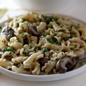 A bowl of pasta with creamy camembert sauce