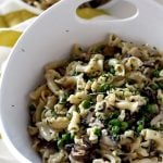 A bowl of Pasta with mushrooms, peas, and creamy camembert sauce