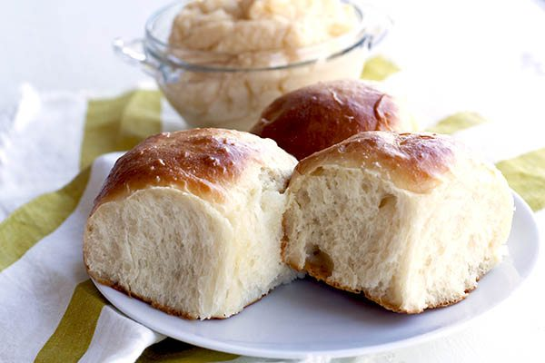 potato rolls on a white plate.