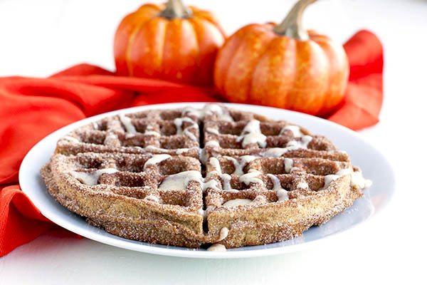 A pumpkin churro waffle on a plate