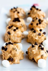 Cookies on a white platter garnished with mini chocolate chips and mini marshmallows.