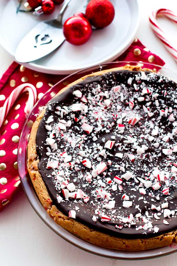 This Peppermint Bark Sugar Cookie Pie is a delicious, festive dessert that is perfect for holiday entertaining and SO easy to make. Peppermint, dark chocolate, and sugar cookie-how could you go wrong?!
