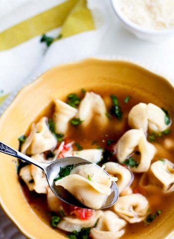 A spoonful of Tortellini Soup in a bowl