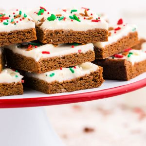A close up picture gingerbread bars stacked on top of each other.