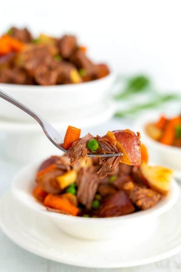 Grabbing a fork full of stew.
