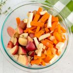 Place the chopped potatoes, carrots, and parsnips in a bowl.