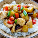 Sheet Pan Stir-Fried Chicken Teriyaki over rice in a bowl