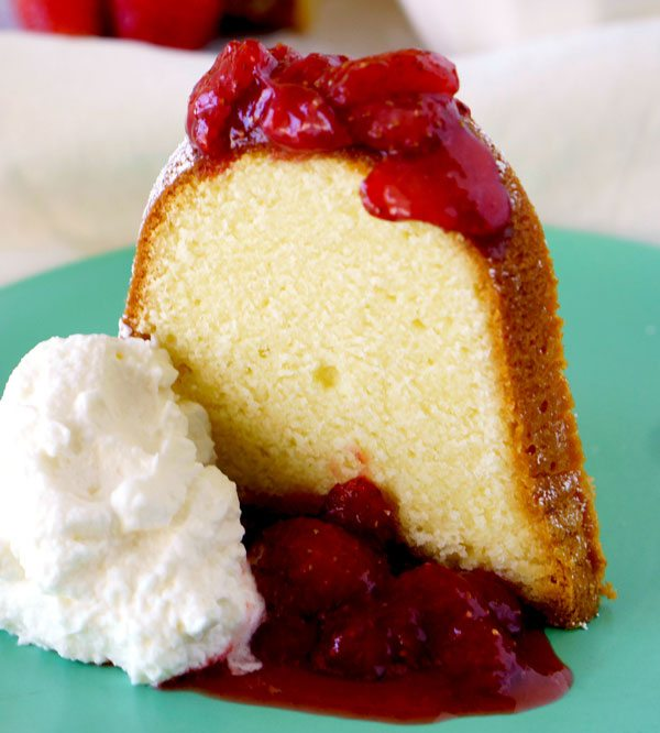 A slice of Cream Cheese Pound Cake with Strawberry Topping on a plate