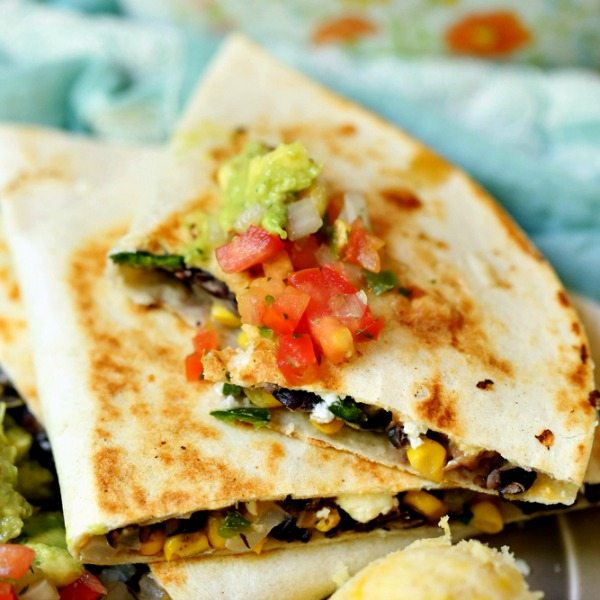 Loaded vegetarian quesadilla with goat cheese corn black beans this vegetarian quesadilla recipe is loaded with goat cheese cheddar corn black beans and poblano peppers its a quick and easy recipe and great for forumfinder Choice Image