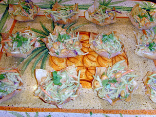 Top view of Asian coleslaw with Thai Peanut Dressing in Wonton Cups on a serving platter
