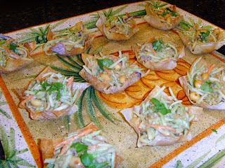 Asian Coleslaw with Thai Peanut Dressing in wonton cups on a serving platter