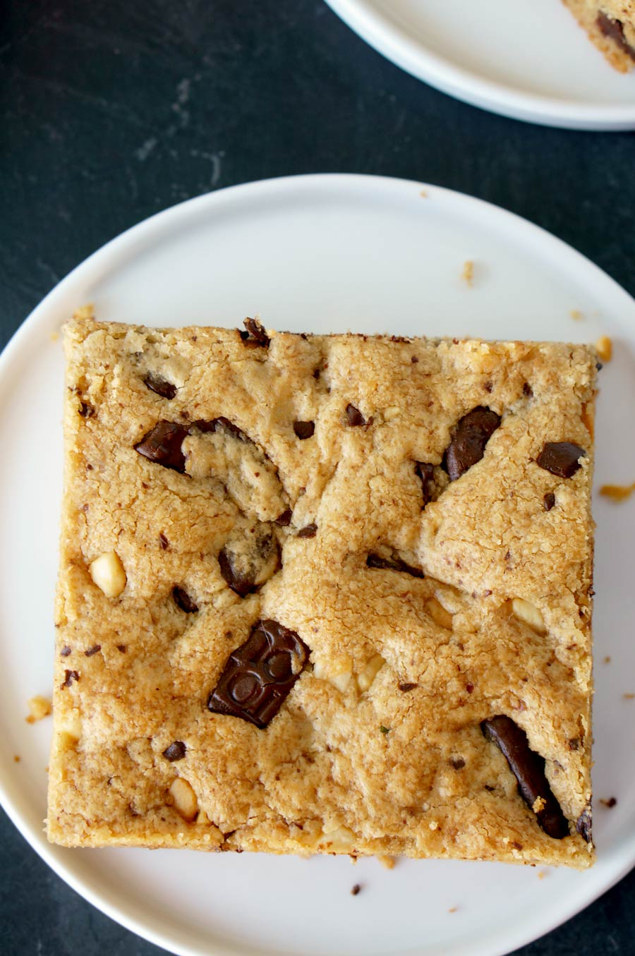 Peanut Butter Cookie Bars with a lot of dark chocolate chunks