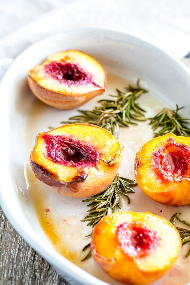 Roasted peaches with rosemary and brown sugar on a plate
