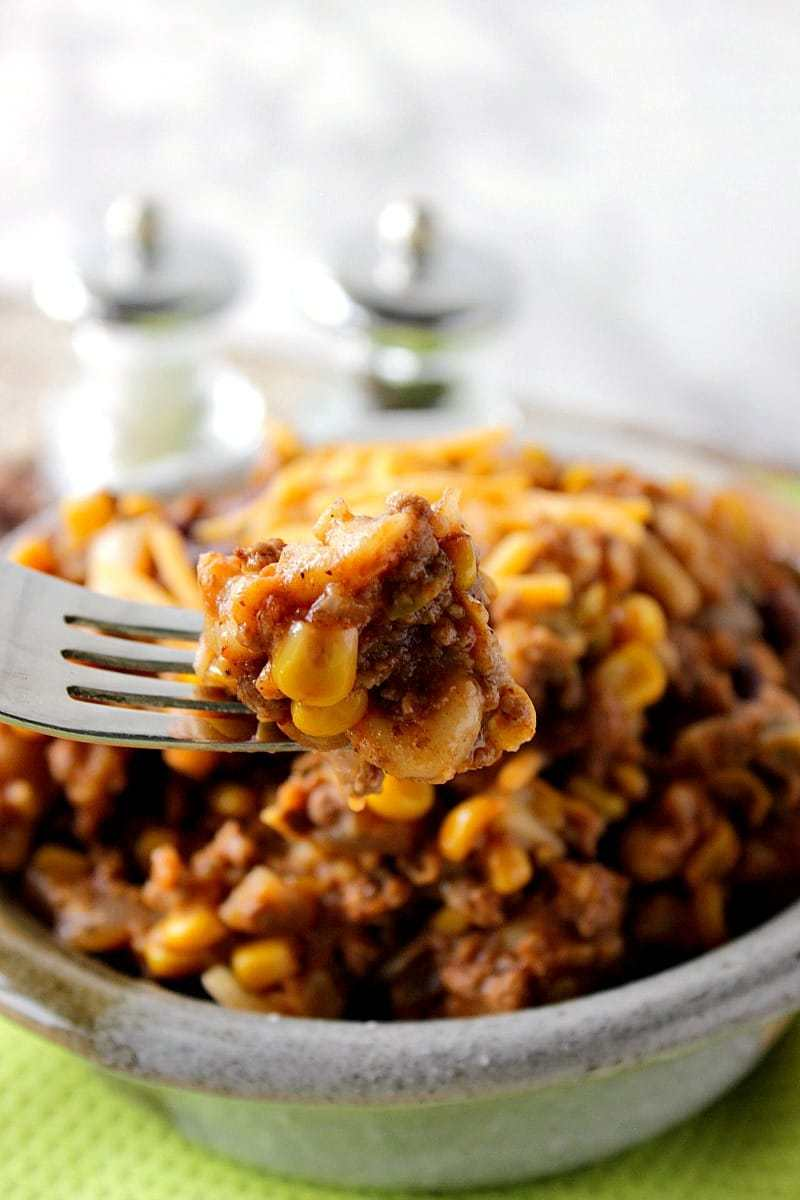 A close-up of a bite of Chili Mac and Cheese