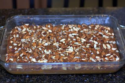 process shot of making almond roca in a 9x13 baking dish