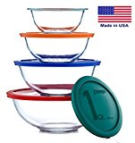 Various sizes of glass mixing bowls with colored lids