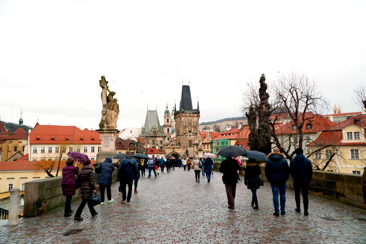Walking across the St. Charles Bridge in Prague, Czechia.