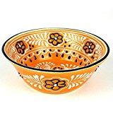 A decorative large serving bowl