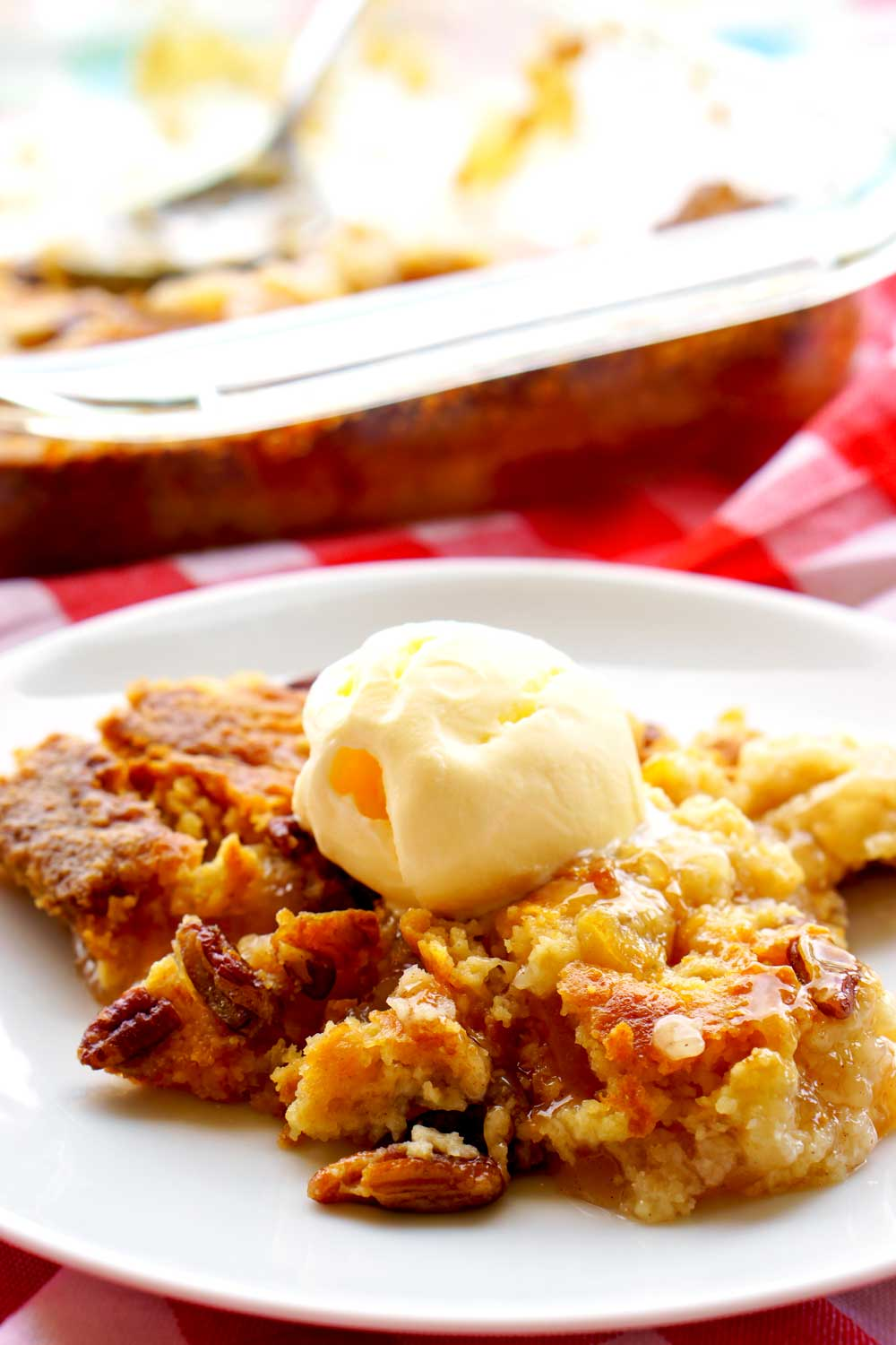 A dump cake is one of the simplest desserts you can make. They're usually made with a base of canned pie filling, a layer of dry cake mix, and pads of butter on top. There is no stirring involved with dump cakes, and true to their name, you just dump the ingredients into the pan and that's it!