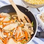 Stirring in bean sprouts and noodles while making Chicken Chow Mein