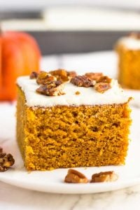 This Pumpkin Cake is one of our favorite Fall desserts. I find myself making it for Sunday dinners, celebrations and even potlucks! My kids love helping me decorate the top with either candied pecans or candy corn, YUM!