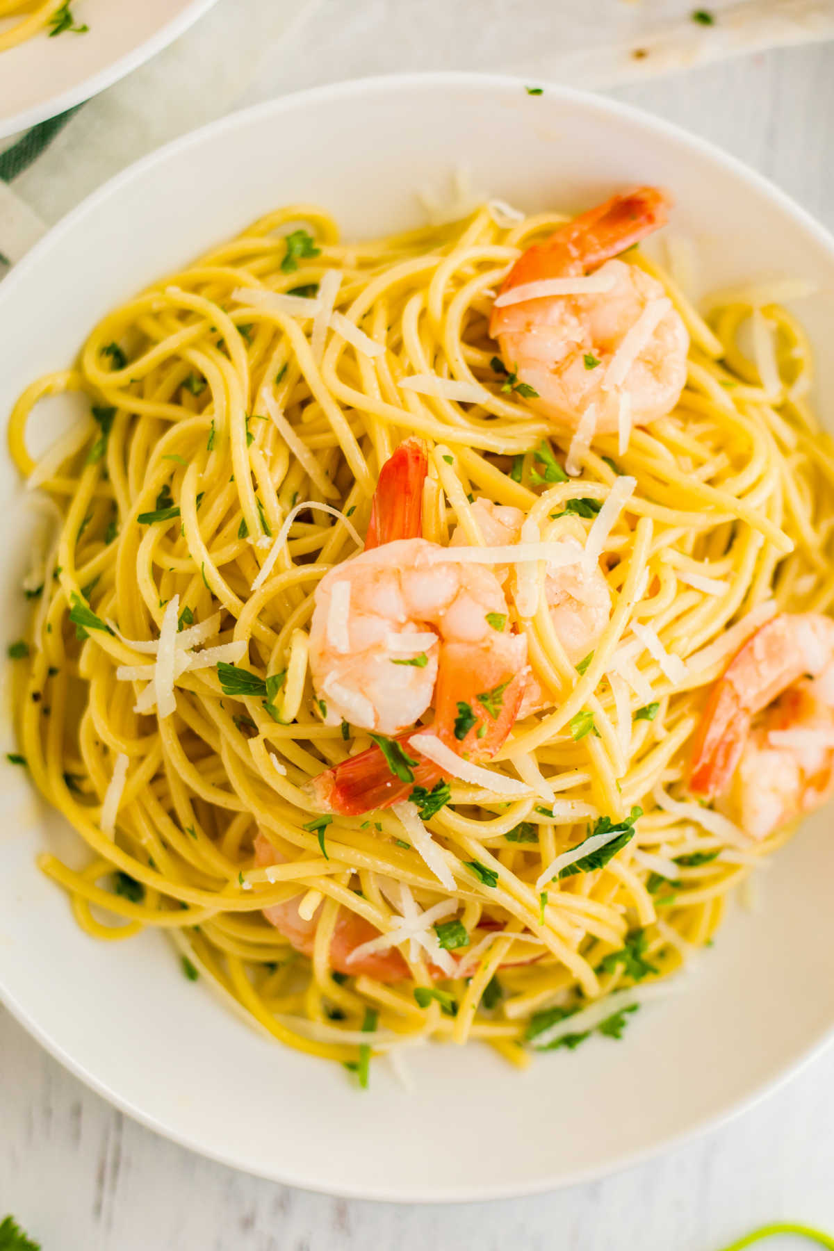 An overhead picture of Shrimp Scampi in a white bowl.