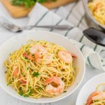 "The word ""scampi"" refers to an Italian dish made with lobster or shrimp that's poached in white wine, garlic, and chicken stock and served with parmesan cheese. Scampi can refer to the cooking style or the lobster or shrimp themselves. Shrimp Scampi is the same as above but served over pasta, usually spaghetti or linguine."