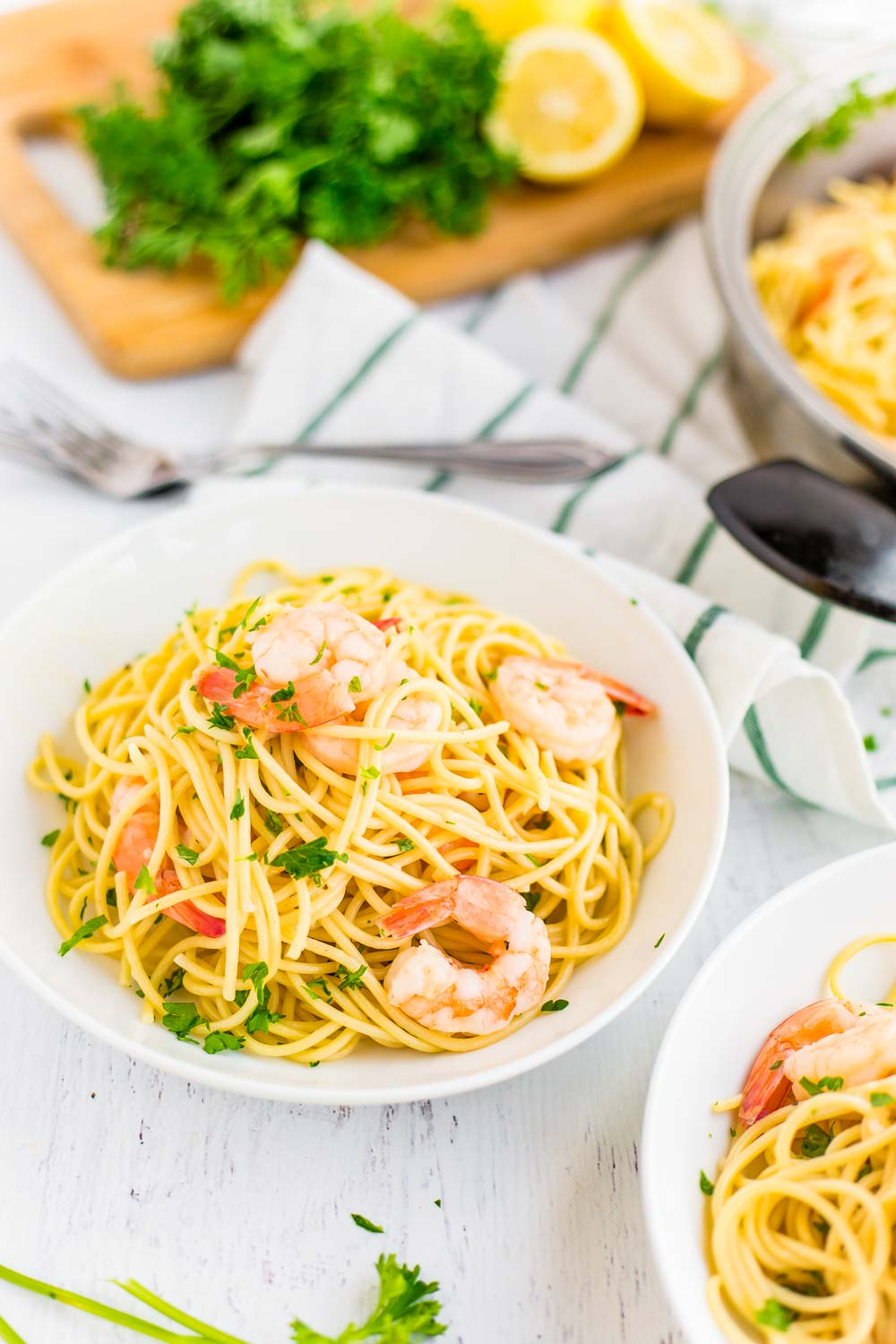 The finished Shrimp Scampi in white pasta bowls.