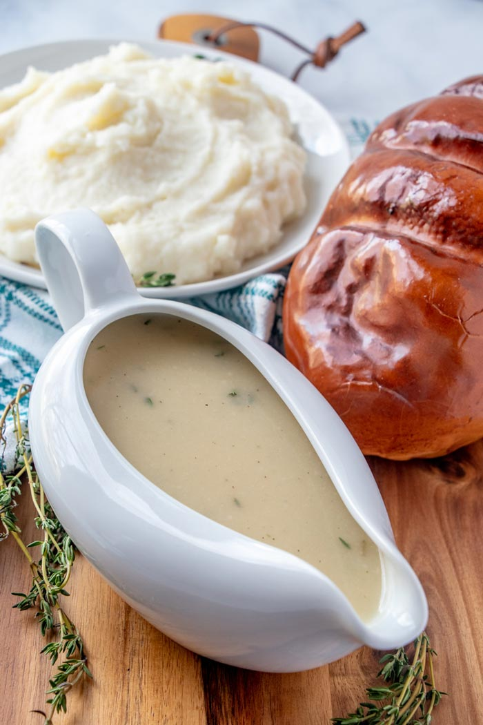 Overhead picture of gravy in a white serving dish.