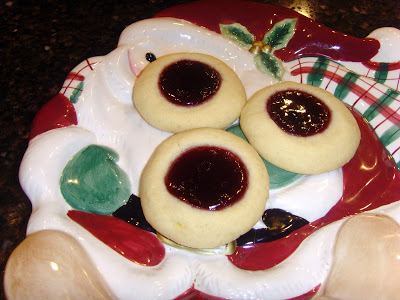 Lemon and Raspberry Jam Thumbprint cookies on a Santa plate