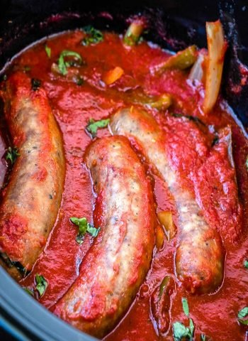 The finished sausage and peppers in a crockpot.