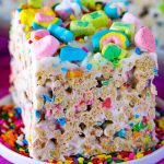 A close up picture of a Lucky Charms Bar on a white plate.