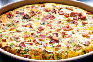 Bake the casserole until the eggs are set.