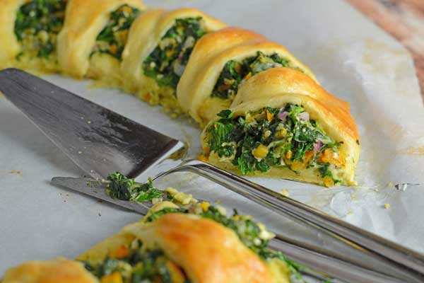 Spinach Ring with a slice cut out of it