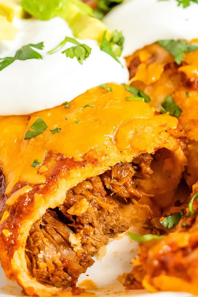 These Shredded Beef Enchiladas are packed with slow-cooked shredded beef that's been braised and smothered in homemade enchilada sauce. via @foodfolksandfun
