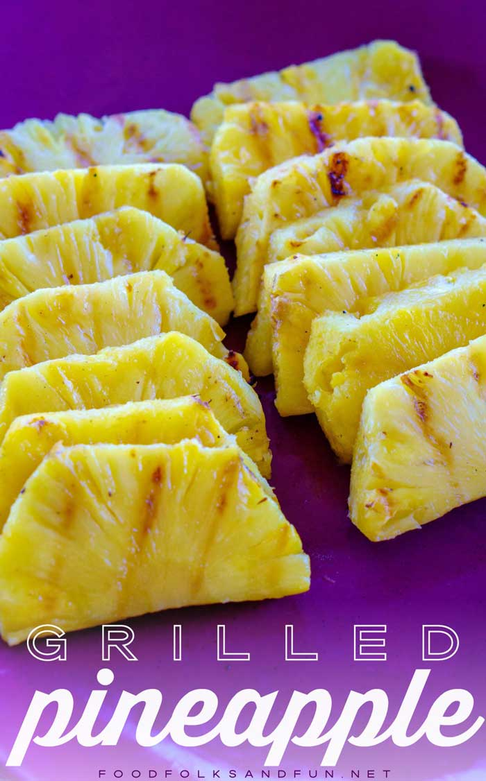 Grilled pineapple on a platter ready to be served.