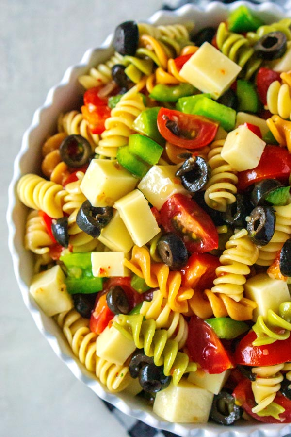 An overhead picture of pasta salad in a white bowl.