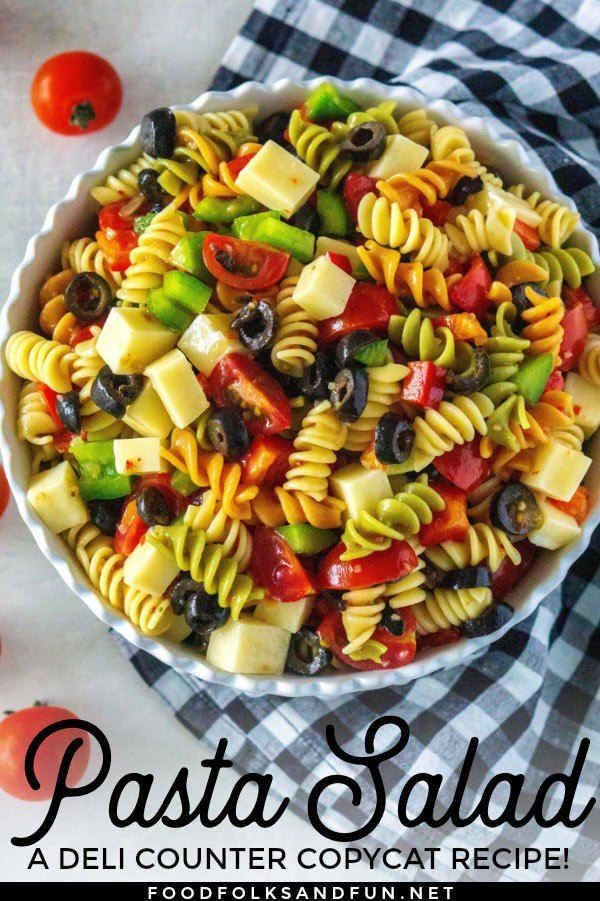 This easy pasta salad recipe is made with tricolor rotini, Italian dressing, mozzarellacheese, bell peppers, black olives, and cherry tomatoes. You'll be eating this pasta salad all summer long because the variations are endless, plus it's so easy to make! via @foodfolksandfun