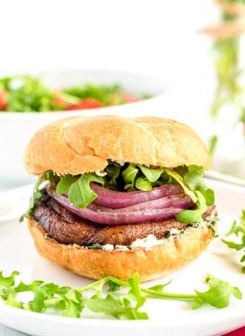 Portobello Mushroom Burger on a white plate with arugula.
