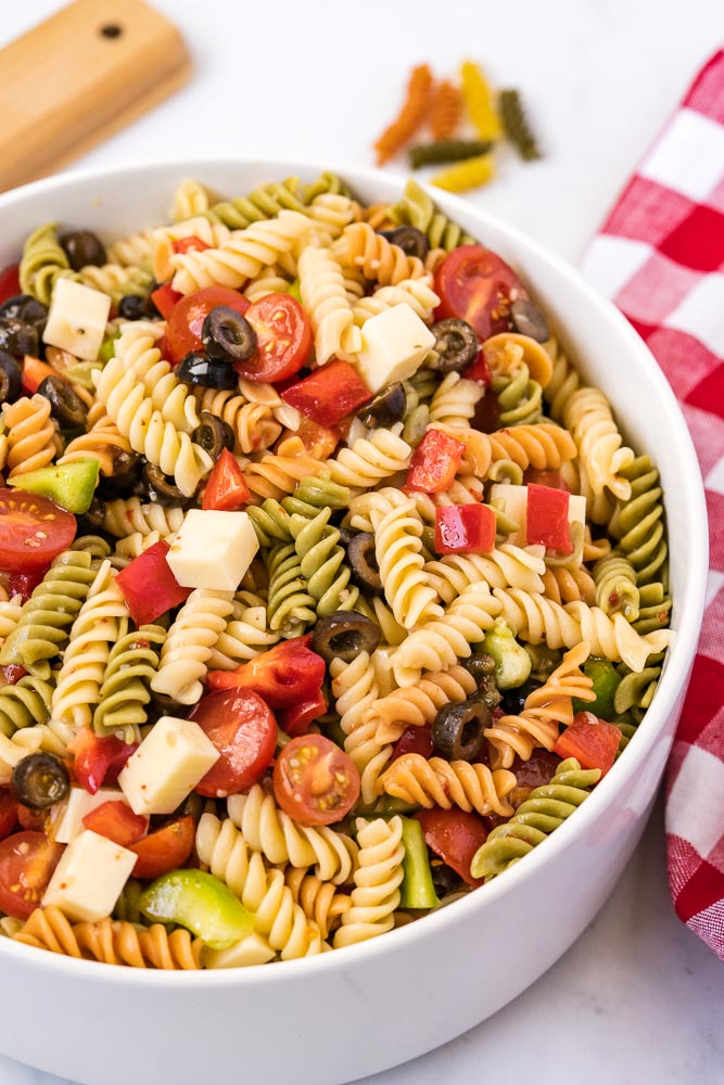 The finished Tri Color Pasta Salad recipe in a white serving bowl.