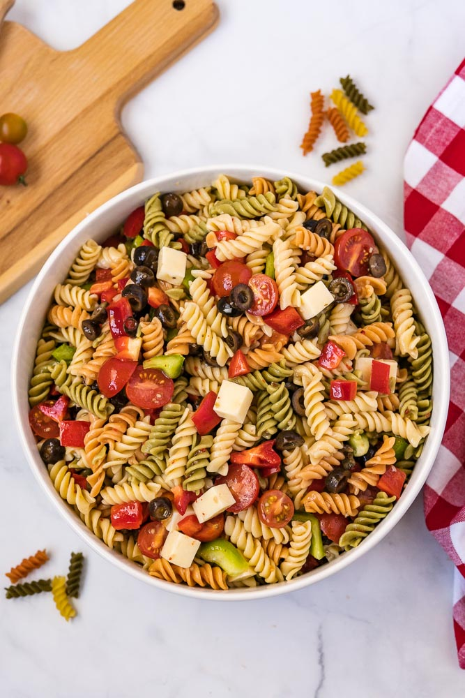 The finished Tri Color Pasta Salad made with Italian Dressing in a white serving bowl.