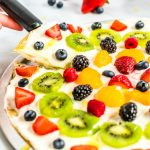 The finished fruit pizza with text overlay for Pinterest.